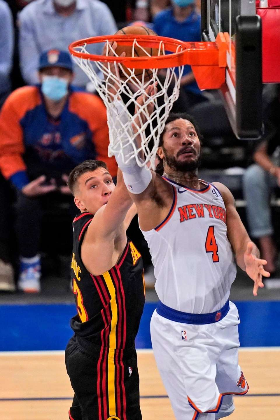 New York Knicks' Derrick Rose, right, drives to