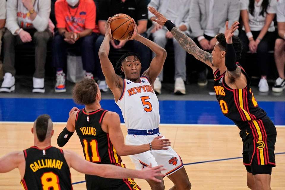 New York Knicks' Immanuel Quickley (5) looks to
