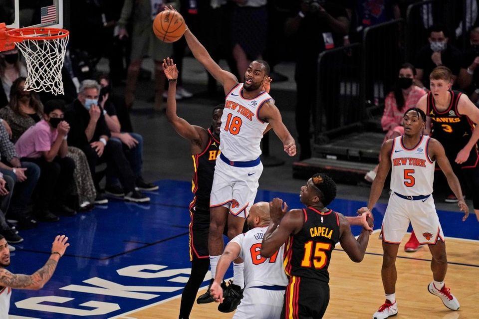 New York Knicks' Alec Burks (18) grabs a
