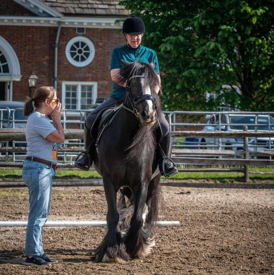 Suzanne Ament, a blind dressage competitor, listens to