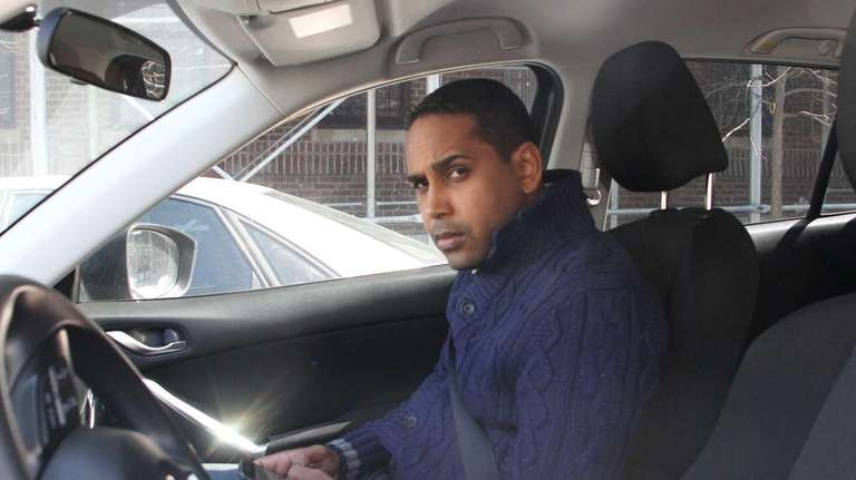 Nelson Castro is pictured inside a car outside