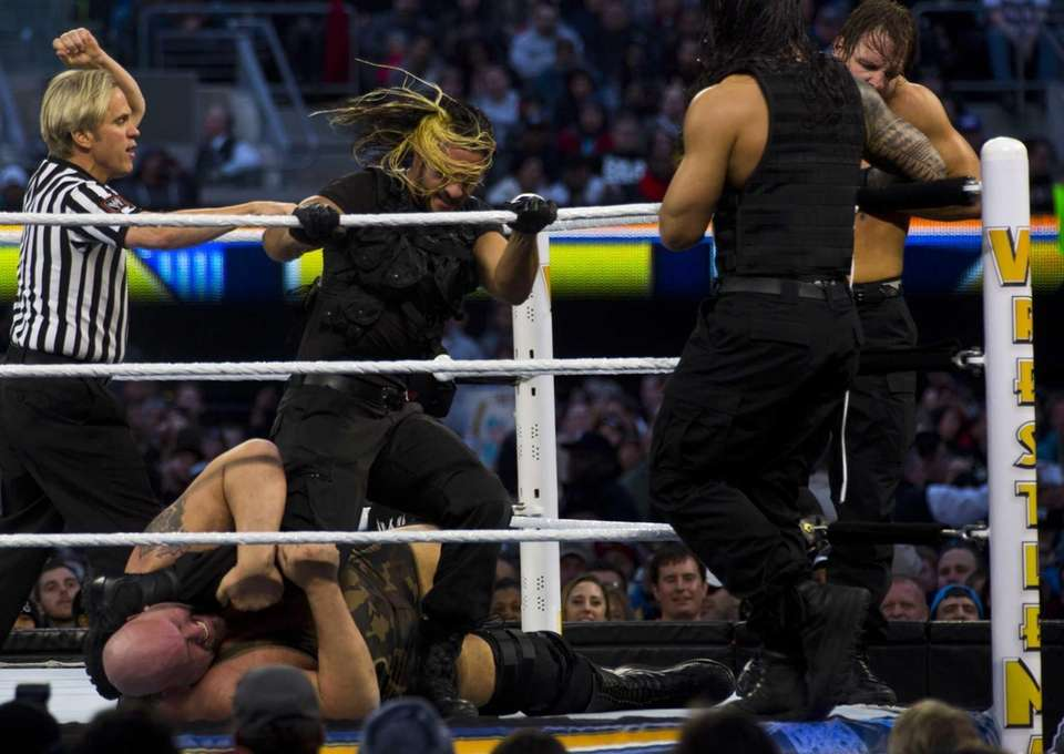Seth Rollins of The Shield stomps on Big