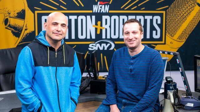 Craig Carton, left, and Evan Roberts sit in