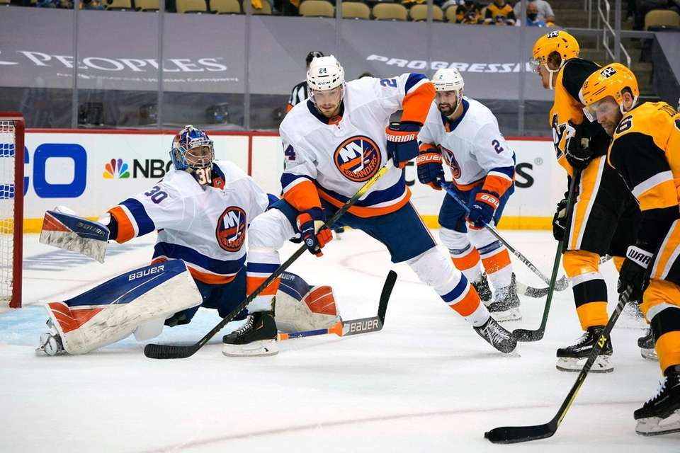 Pittsburgh Penguins' Jason Zucker, right, can't get off