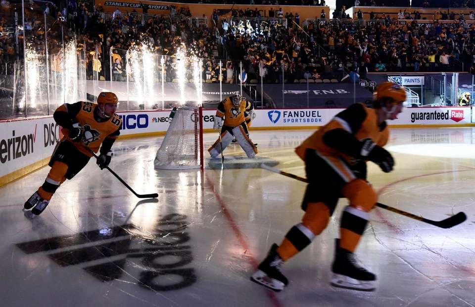 The Pittsburgh Penguins skate onto the ice prior