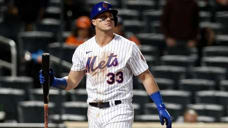 James McCann of the Mets strikes out to