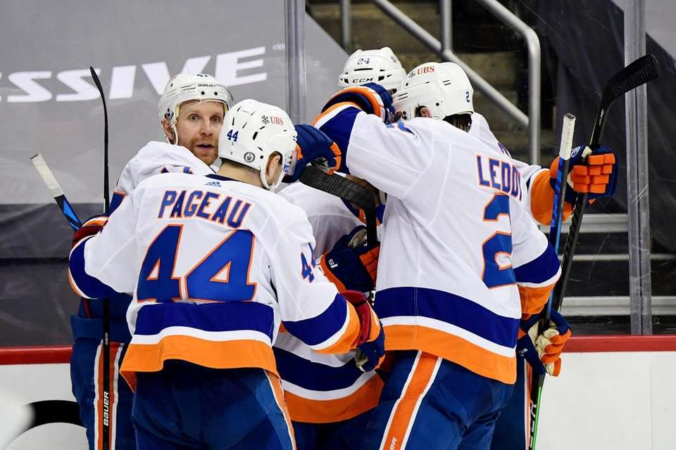 The New York Islanders celebrate a goal by