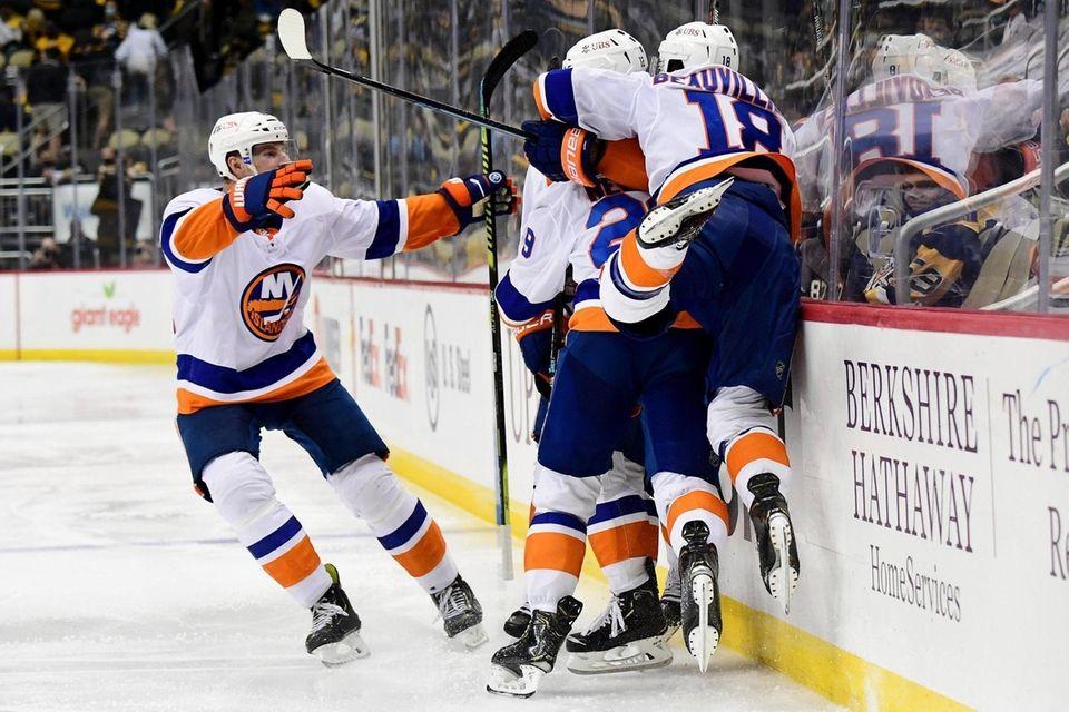 The New York Islanders celebrate the game winning