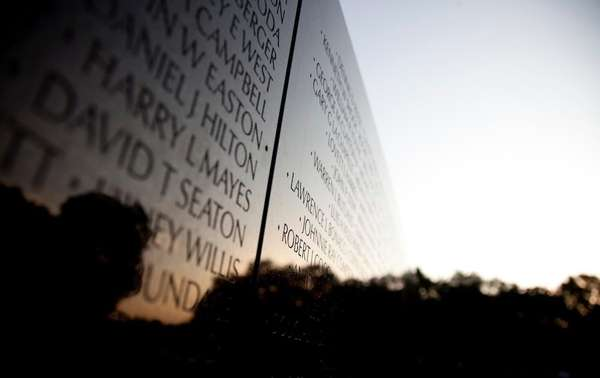 The Vietnam Veterans Memorial Wall is seen as
