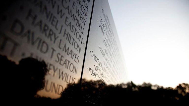 The Vietnam Veterans Memorial Wall is seen as