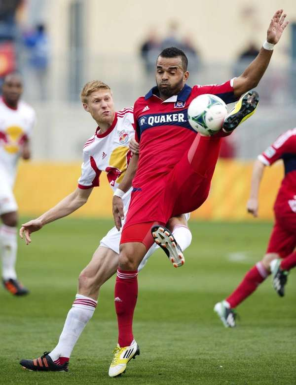Chicago Fire forward Maicon Santos, right, kicks the