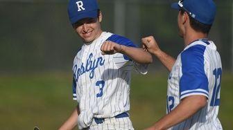 Hayden Leiderman #3, Roslyn pitcher, left, gets congratulated