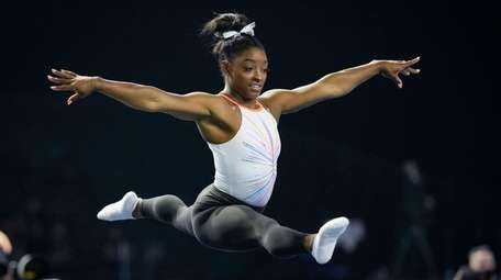 Simone Biles warms up before competing in the