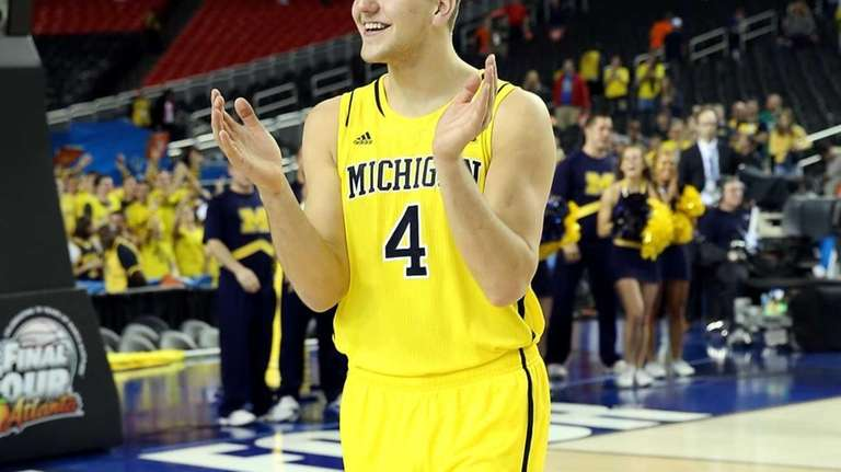 Michigan's Mitch McGary celebrates the Wolverines' 61-56 victory