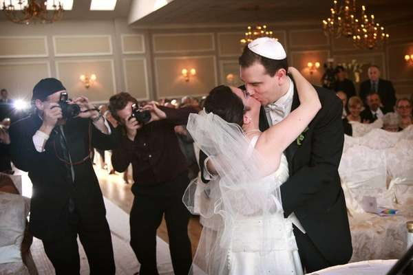 Paul Forziano kisses his bride, Hava Samuels, after the disabled couple was wed in a ceremony in Wading River. (April 7, 2013)