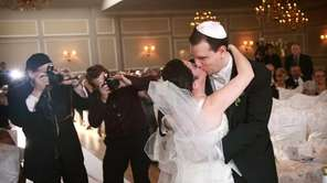 Paul Forziano kisses his bride, Hava Samuels, after
