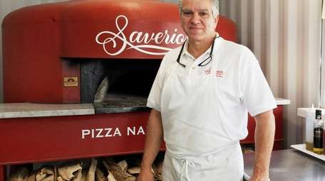 """Saverio """"Sam"""" Cataldo stands in front of the"""