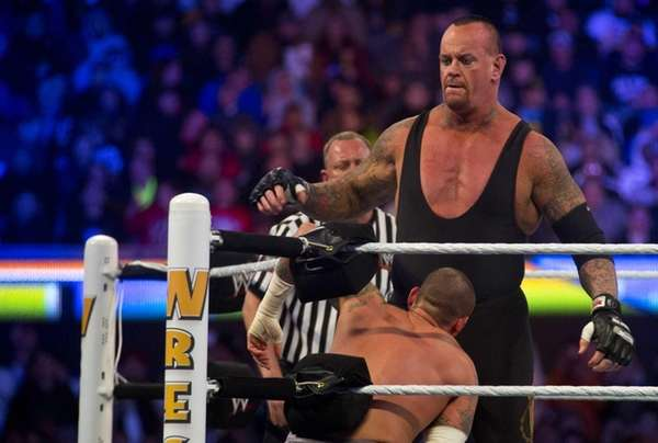 The Undertaker vs. CM Punk wrestle during WrestleMania