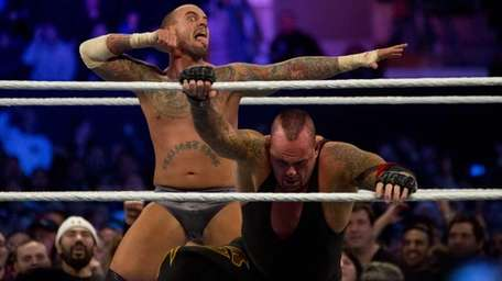 The Undertaker and CM Punk wrestle during WrestleMania