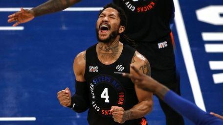 The Knicks' Derrick Rose celebrates late in the