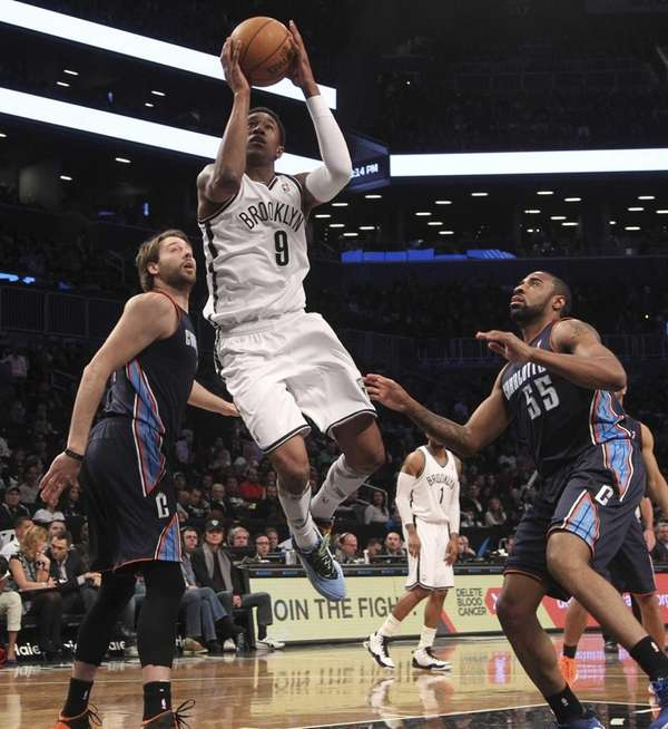 MarShon Brooks goes up past the Charlotte Bobcats'