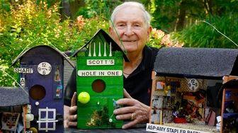 Jerry Abel, of Woodbury, displays the birdhouses he