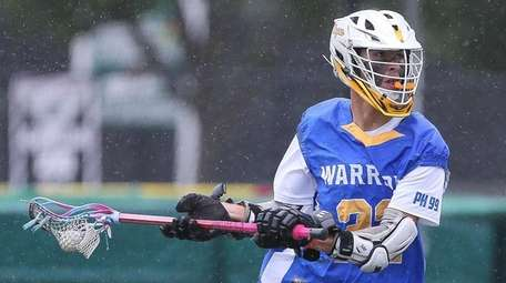 Comsewogue's Corey Watson (22) looks to pass in