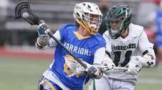 Comsewogue's Vincent Herbstman (21) looks to get by