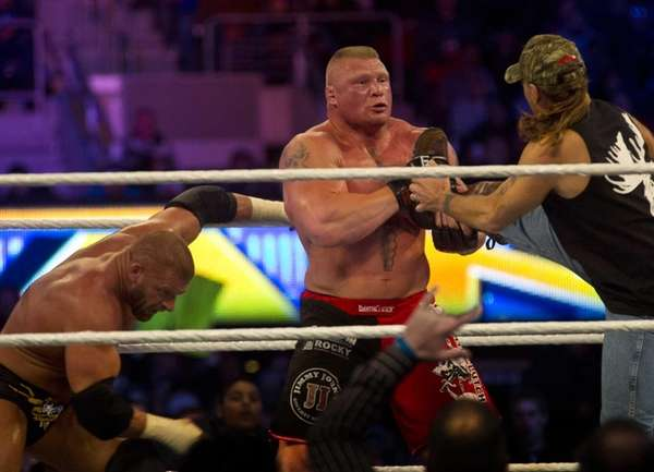 Triple H (with Shawn Michaels) and Brock Lesnar