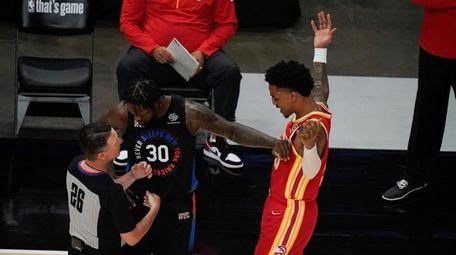 New York Knicks' Julius Randle (30) pushes Atlanta