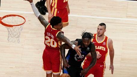 Atlanta Hawks' John Collins (20) attempts to block