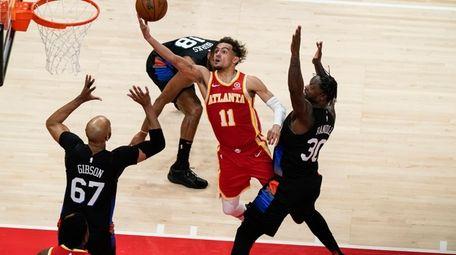 Atlanta Hawks' Trae Young (11) shoots against New