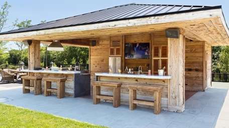An outdoor kitchen designed by Showcase Kitchens in