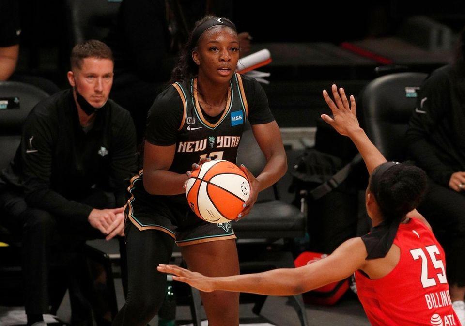 Michaela Onyenwere of the Liberty controls the ball