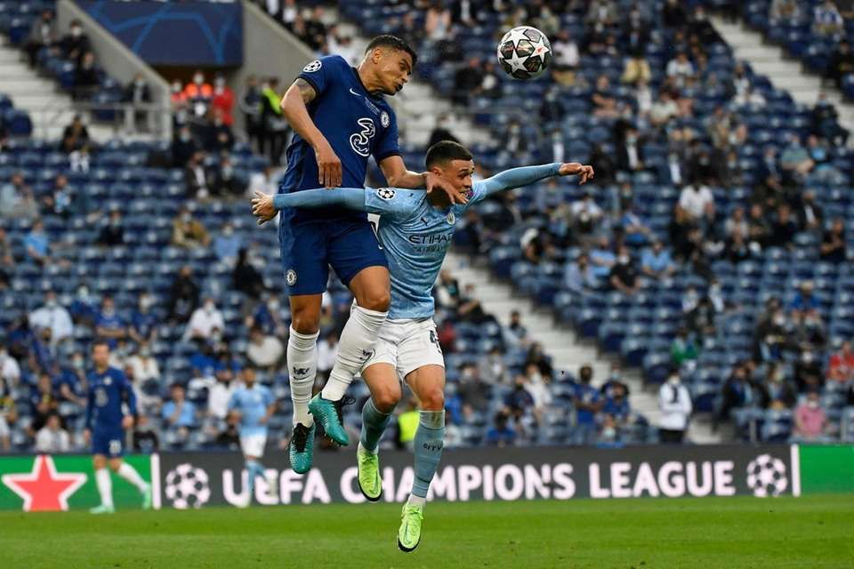 Chelsea's Thiago Silva jumps for the ball with