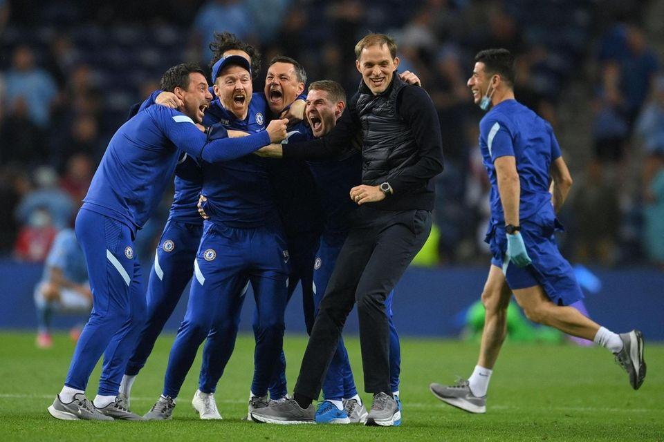 Chelsea's German coach Thomas Tuchel (2nd-R) celebrates with