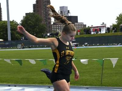 Melissa Cunningham from St. Anthony's crosses the finish