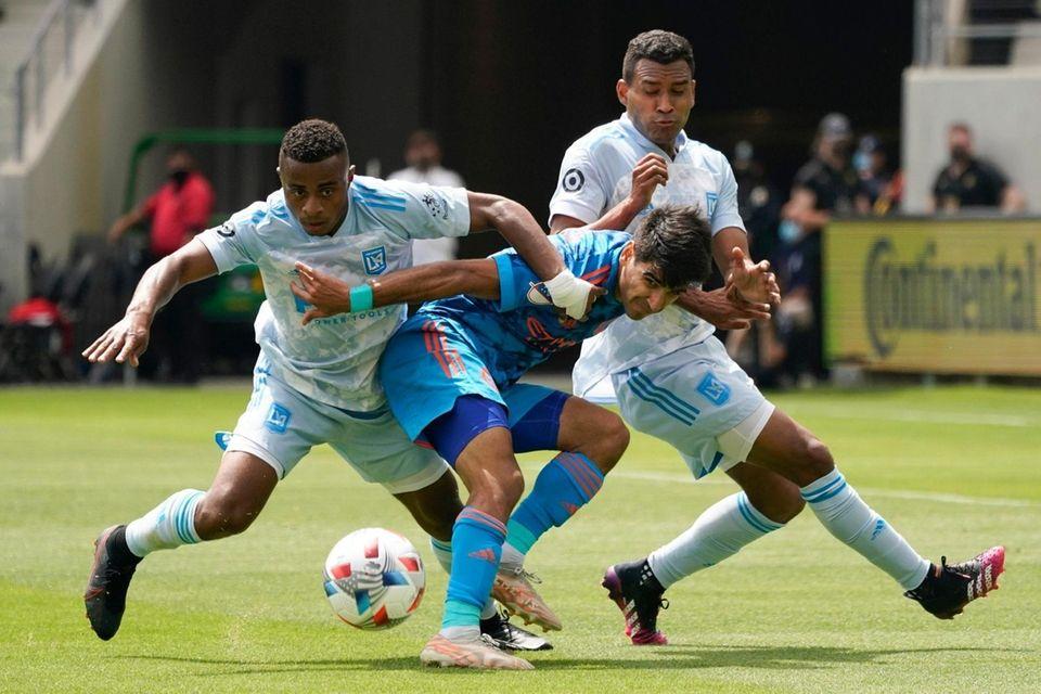 Los Angeles FC defender Diego Palacios, left, defender