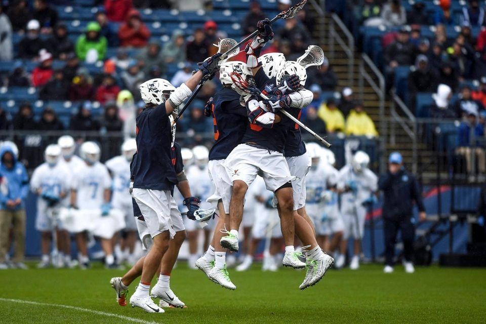 Virginia players celebrate after scoring their sixth goal