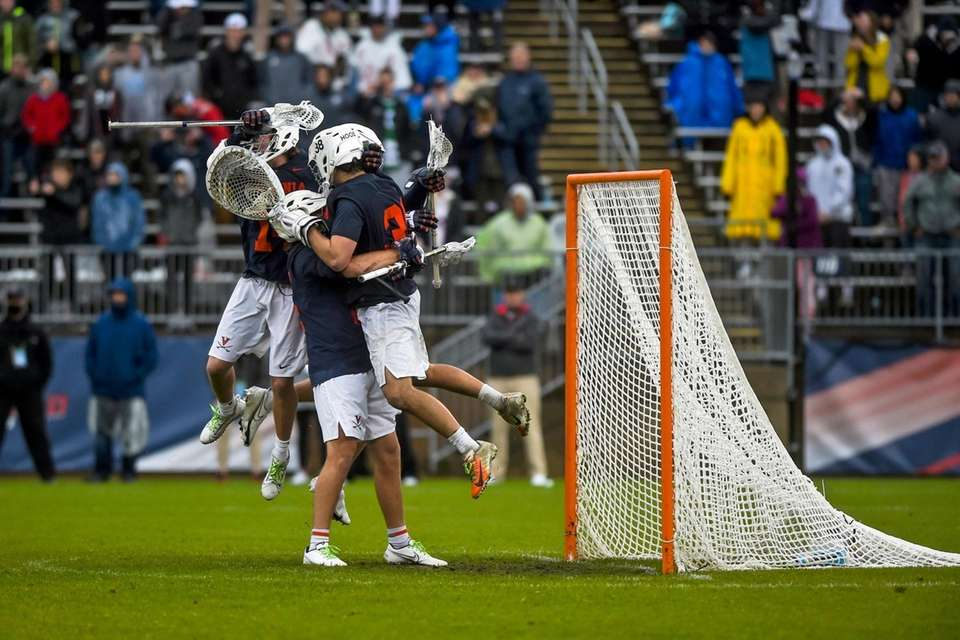 Virginia players celebrate after they defeated North Carolina