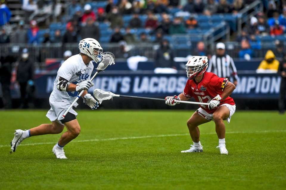 Duke's Brennan O'Neill (34) is guarded by Maryland's