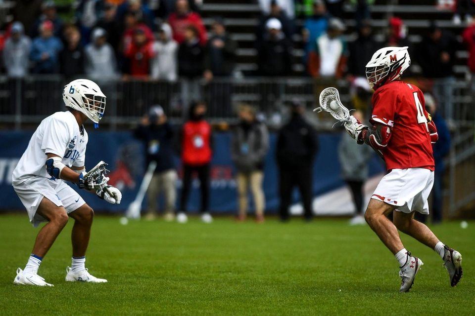 Duke's Jake Caputo (6) guards Maryland's Eric Malever