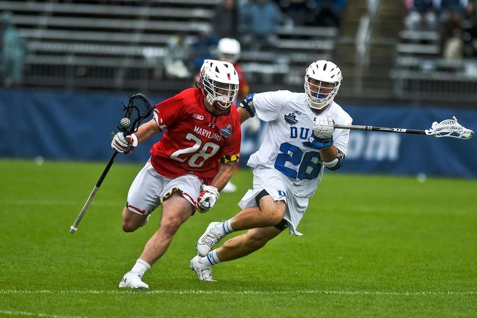 Maryland's Joshua Coffman (28) is guarded by Duke's