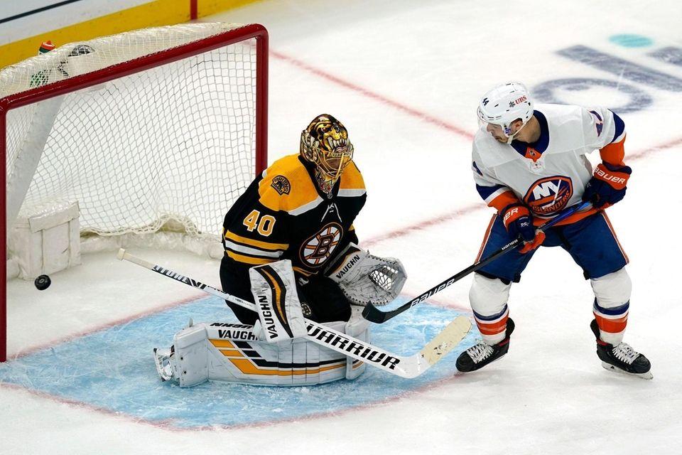 New York Islanders center Jean-Gabriel Pageau, right, watches