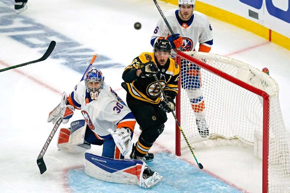 Bruins center Brad Marchand watches the puck go