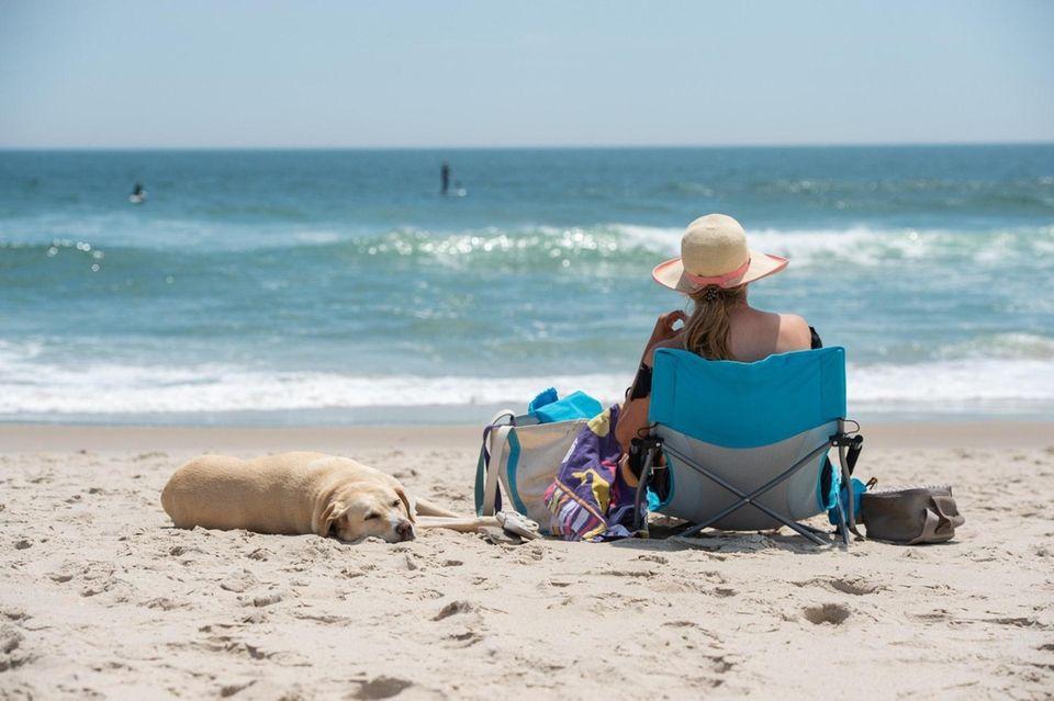 Beachgoers at Ponquogue Beach in Hampton Bays, May