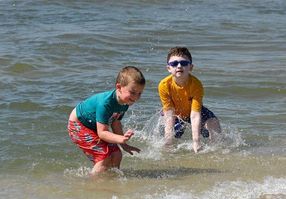 Luke Bujnowski, 5, left, of Holbrook, cools off