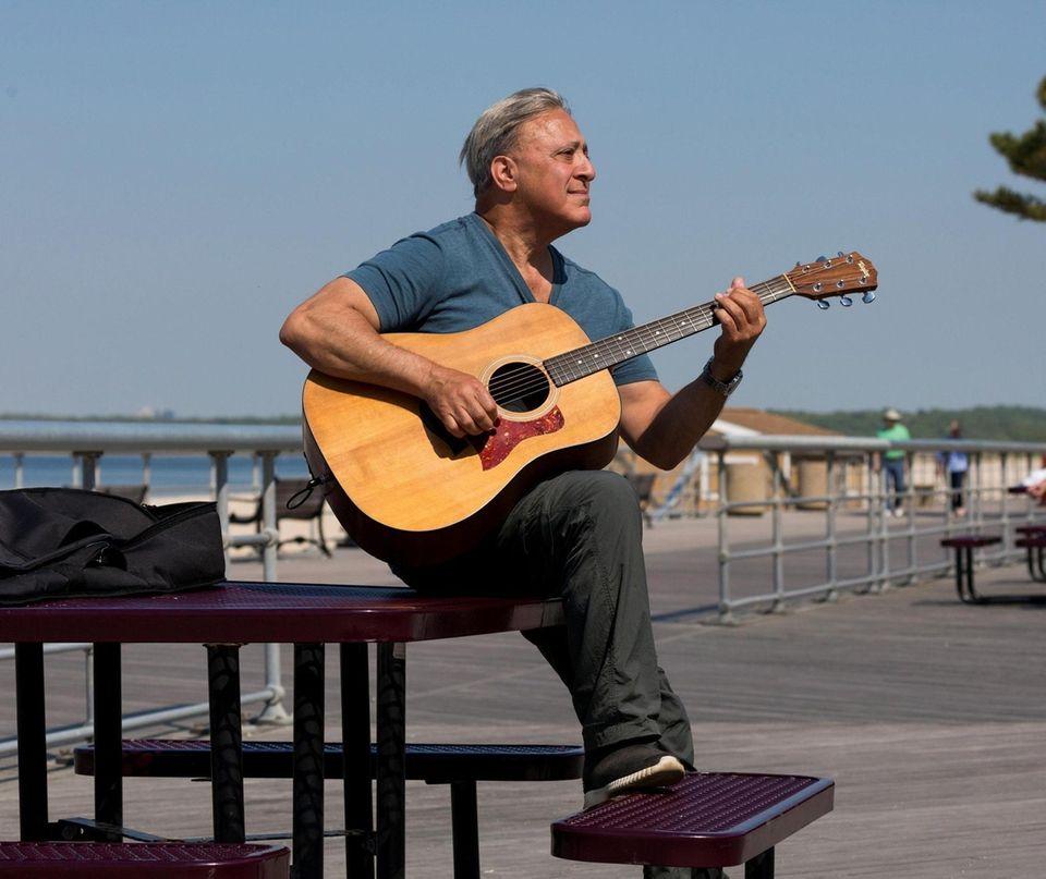 Matt Ricetti of Plainview plays his guitar at