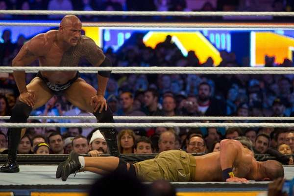 The Rock and John Cena wrestle during WrestleMania