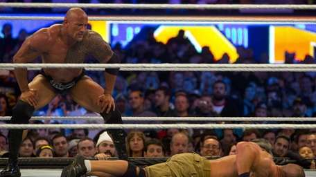 The Rock and John Cena wrestle during WrestleMania